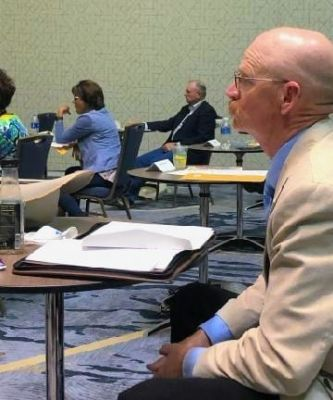 South Dakota Cattlemen's President Eric Jennings and VeaBea Thomas and Myron Williams socially distancing while representing SDCA and the SD Beef Industry Council at the NCBA Board of Directors meeting during the NCBA summer business meeting.