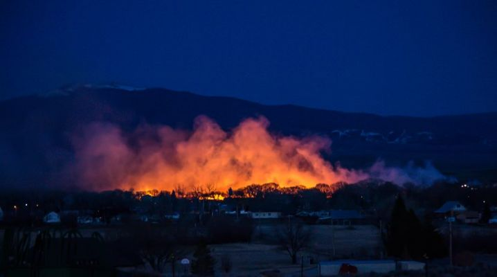 Fire was burning through wood chips and sawdust at the Saratoga, Wyoming sawmill Monday night.