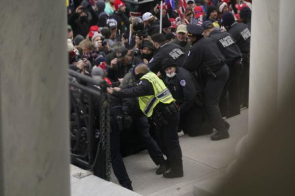 U.S. Capitol Police try to hold back protesters outside the U.S. Capitol, Wednesday, Jan 6, 2021.