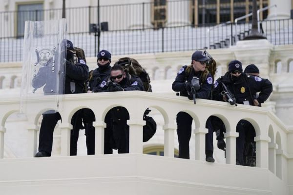 Police monitor the situation in Washington Wednesday as Trump supporters storm the Capitol.
