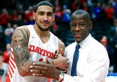 In this Feb. 22, 2020, file photo, Dayton's Obi Toppin, left, celebrates scoring his 1,000th career point with head coach Anthony Grant after an NCAA college basketball game against Duquesne, in Dayton, Ohio. Toppin and Grant have claimed top honors from
