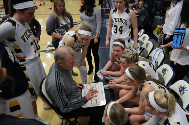 Augustana Coach Dave Krauth draws up a play.