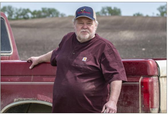Paul Ivesda watches as volunteers plant crops on his farm June 3, 2020 in Edmore, N.D. The wet spring offered only a tiny window for planting, so when Ivesdal fell ill to a coronavirus infection he knew the timing couldn't be worse. Thanks to Farm Rescue
