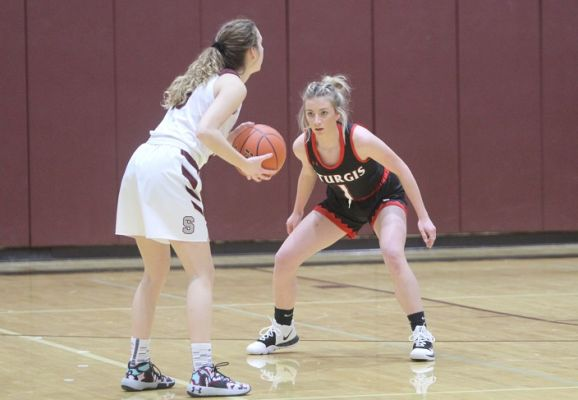 Kylie Shaw (1) defends against Spearfish in Friday night action.