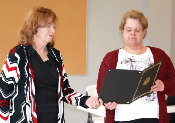 Newell School District Superintendent Robin Dutt (right) presents Delores Johnston with a Proclamation from SD Governor Kristi Noem for her 50 years of service.