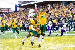 James Madison quarterback Ben DiNucci (6) throws a pass as North Dakota State defensive end Derrek Tuszka (91) attempts to tackle him during the first half of the FCS championship NCAA college football game, Saturday, Jan. 11, 2020, in Frisco, Texas.