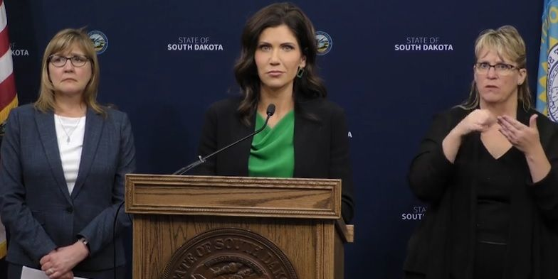 Governor Noem listens to a question about Native American tribes operating checkpoints at her Thursday press conference.