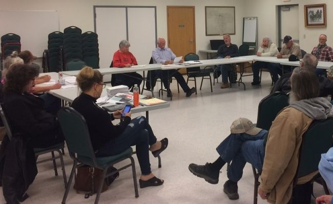 Members of the Rural Sturgis Ambulance Group discuss setting up an ambulance district at a recent meeting.