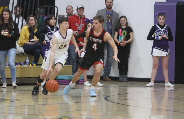 Jace Kelley (23) works around Josh Fowler (4) Saturday night in Custer.