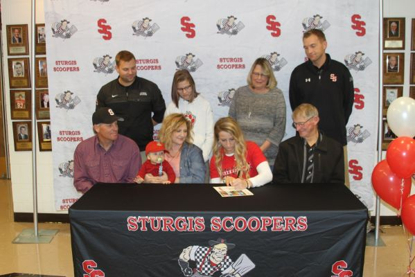 Sydney Shaw signs a Letter of Intent to attend the University of South Dakota as a walk-on track and field athlete. Back row:  Coach Chris Koletzky, sister Erin Shaw, Grandmother Laura VanDervoort, Coach Blake Proefrock.  Front row: father Jim Shaw, broth