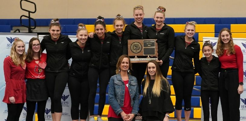 Deuel celebrates winning the Class A State Gymnastics team title Friday.