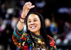 In this Dec. 15, 2019, file photo, South Carolina head coach Dawn Staley participates in the school anthem after an NCAA college basketball game against Purdue in Columbia, S.C. The veteran Gamecocks coach was announced as The Associated Press women's bas