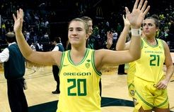 In this Nov. 16, 2019, file photo, Oregon's Sabrina Ionescu acknowledges the crowd with teammates after an NCAA college basketball game against Texas Southern in Eugene, Ore. Ionescu capped off a unprecedented college career by entering an exclusive club.