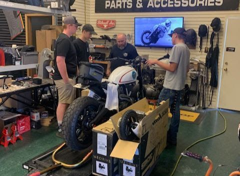 Students working on the custom motorcycle