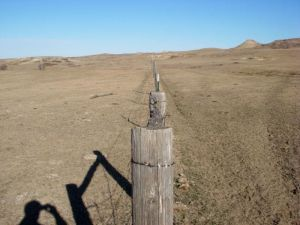 Overgrazed rangeland with poor water holding capacity and increased runoff.